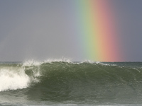 Breaking wave and rainbow